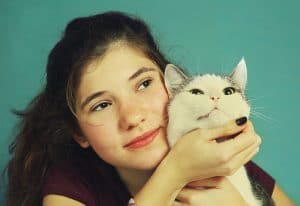 teen girl with long brown hair and cat